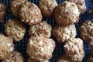 anzac biscuits cooling on a wire rack