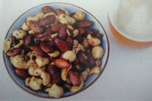 mixed nuts with spices in a small bowl