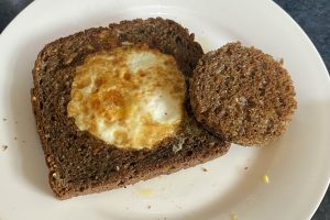 fried toast with egg in the centre and circle of fried toast